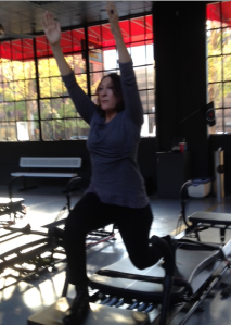 Lenor shows her warrior move - the elevator lunge in an isometric hold with arms extended. You go, Lenor!
